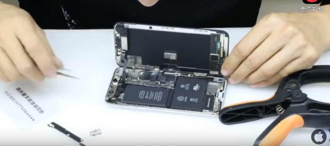 iPhone X with two batteries